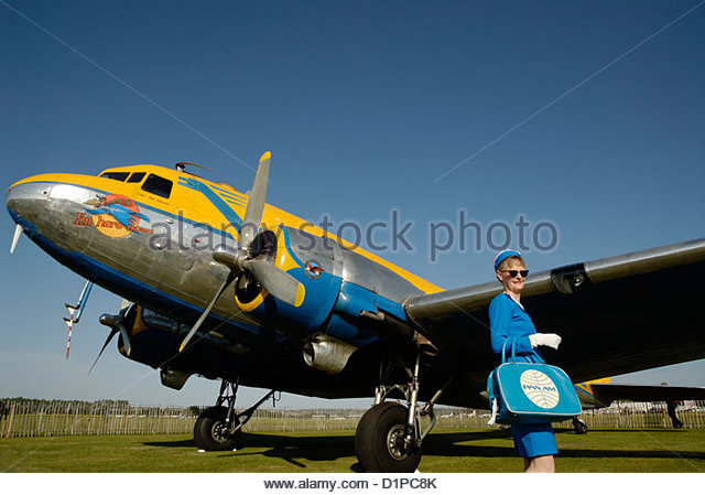 stewardess in PAN AM dress and a Douglas DC-3 - Stock Image