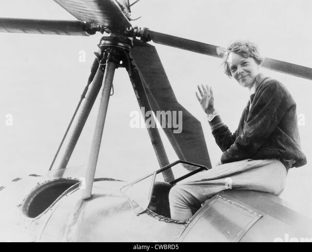 Amelia Earhart (1897-1937), waving, seated outside cockpit on top of an Autogiro, in Los Angeles, shortly after - Stock-Bilder