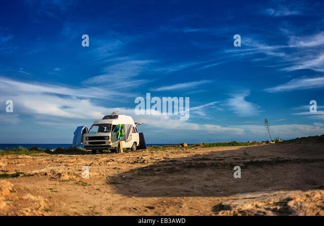Italy, Sicily, Camper van on coastline - Stock Image