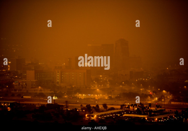 Large dust storm sweeps through downtown Tucson Arizona at dusk. This severe thunderstorm had wind speed clocked - Stock Image
