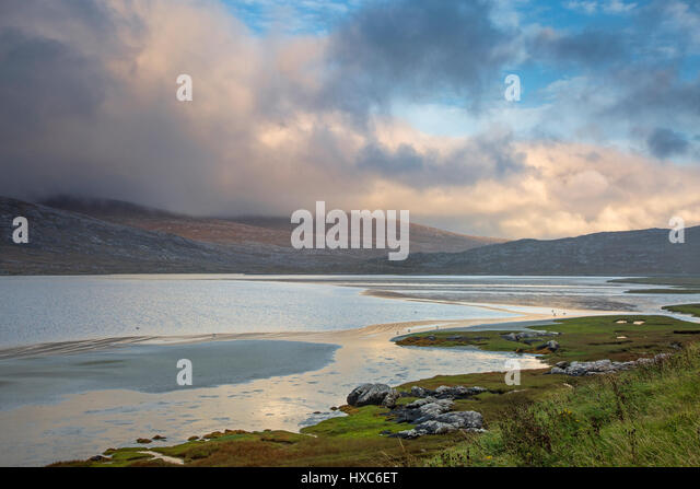 Clouds over mountains and tranquil water, Seilebost, Harris, Outer Hebrides - Stock Image