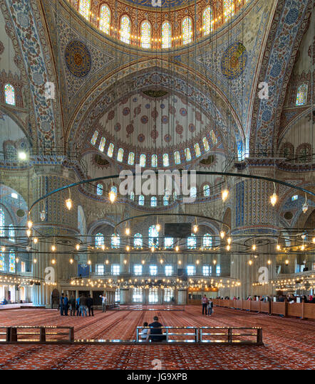 Istanbul, Turkey - April 16, 2017: Interior of Sultan Ahmed Mosque (Blue Mosque), with a huge pillars, arches, colored - Stock Image