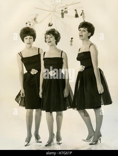 Three singers dressed alike, USA - Stock Image