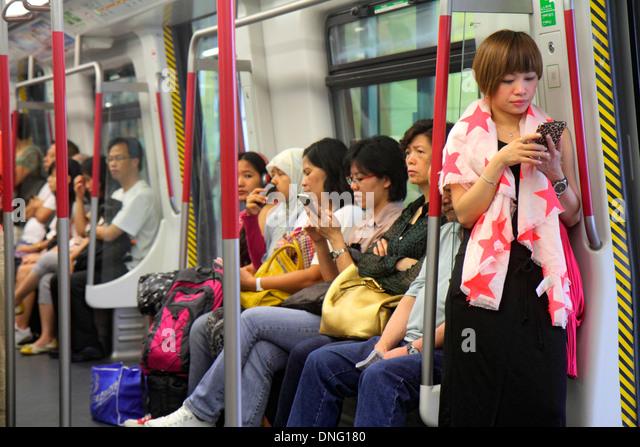 China Hong Kong Hong Kong MTR Subway public transportation Airport Express onboard train cabin passengers riders - Stock Image
