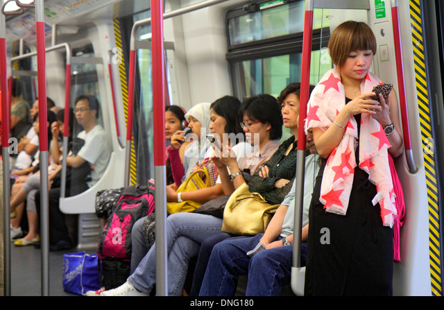 Hong Kong China Hong Kong MTR Subway public transportation Airport Express onboard train cabin passengers riders - Stock Image