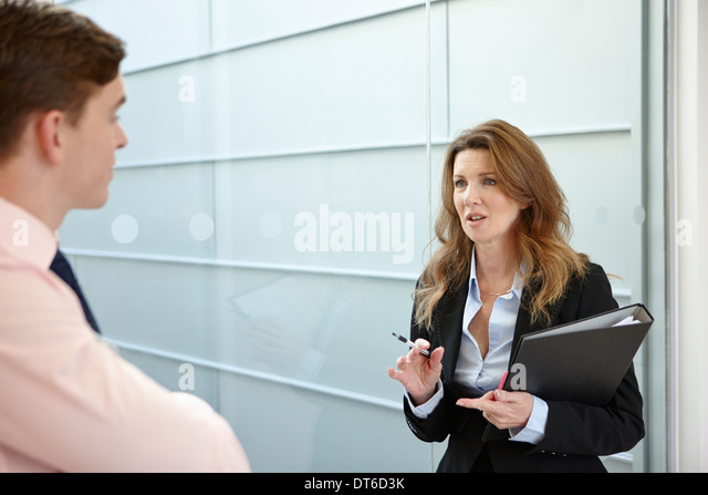 Business colleagues in discussion - Stock-Bilder