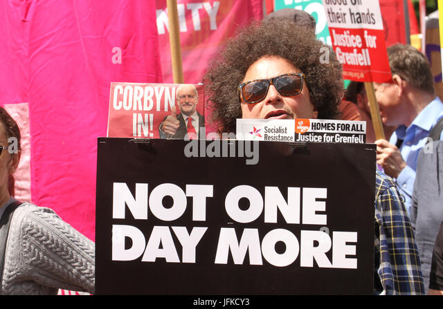 London, UK - 1 July 2017 - A demonstrator hold up a placard witht eh words 'Not One Day More' during the - Stock Image