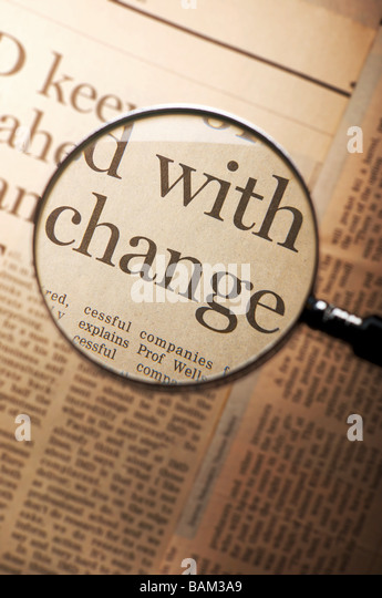 Word change under magnifying glass - Stock Image
