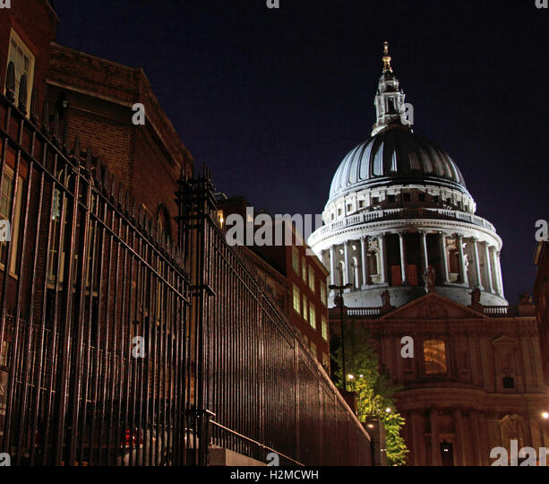 St Pauls Cathedral London late in the evening, against railings - Stock Image
