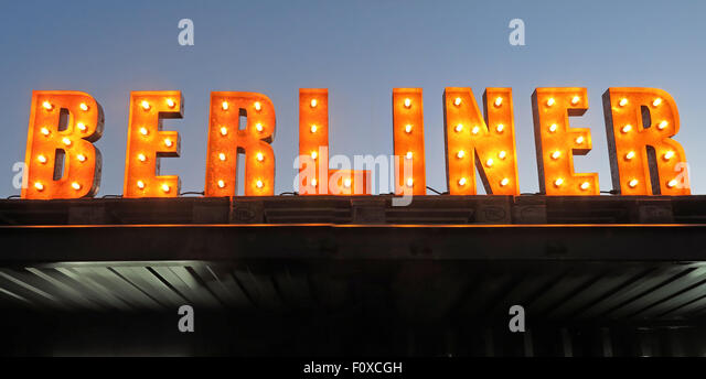 Berliner sign in lights with sky behind, bar serving bier - Stock Image