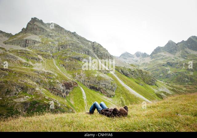 Boy resting, Alps, Tirol, Austria - Stock Image