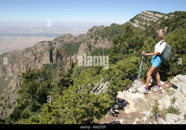 New Mexico Albuquerque Sandia Peak ft. hiker near crest W - Stock Image