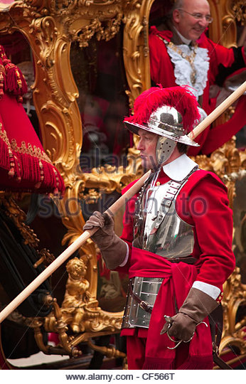 The Rt Hon Michael Bear, Lord Mayor of the City of London, in the gold state coach accompanied by a pikeman of the - Stock Image