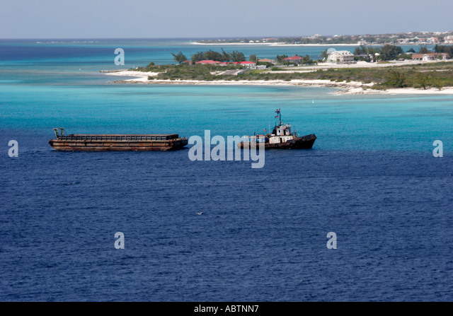 Grand Turk Cockburn Town tugboat barge Turks Island Passage English Point - Stock Image