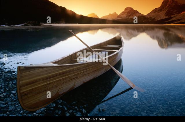 Canoe on Bow Lake at Sunrise, Banff National Park, Alberta, Canada - Stock Image