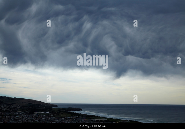 Unusual storm clouds rolling in over St Kilda Beach, Dunedin, Otago, South Island, New Zealand - Stock Image