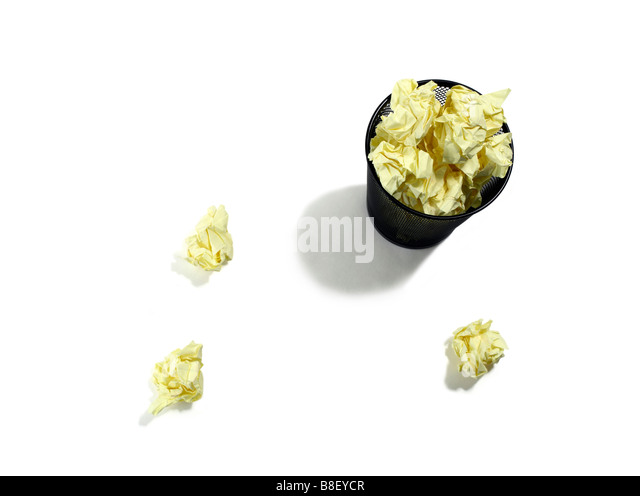 Overflowing wastebasket from overhead - Stock Image