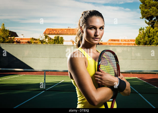 Female tennis player holding racket - Stock Image