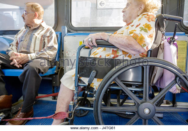 Miami Florida Metrobus mass transit public transportation passenger wheelchair ADA accessibility woman man senior - Stock Image
