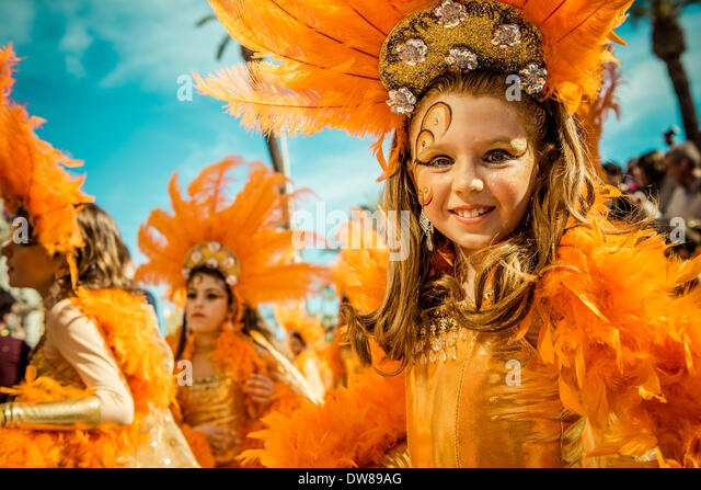 Sitges, Spain. March 2nd, 2014: Children revellers dance during the Sunday parade of the children carnival parade - Stock Image