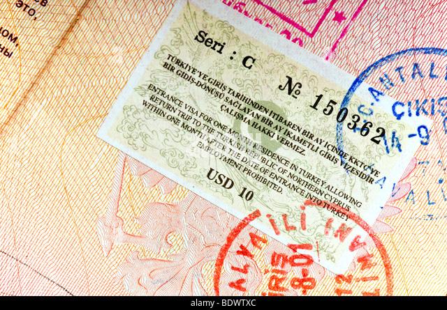 Turkey visa in international passport - Stock-Bilder