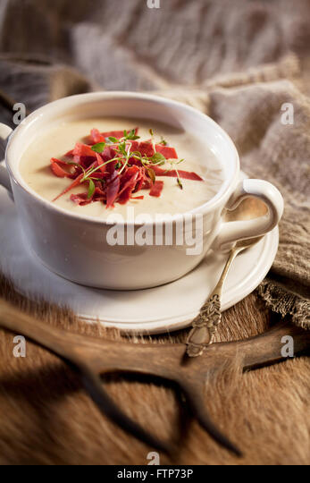 Traditional finnish smoked reindeer soup with thyme - Stock Image