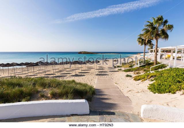 Beach umbrellas on Nissi Beach at the Nissi Beach Resort at Agia Napa in Cyprus - Stock Image