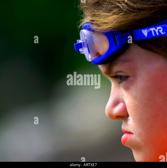 Tight headshot of young girl wearing googles - Stock Image