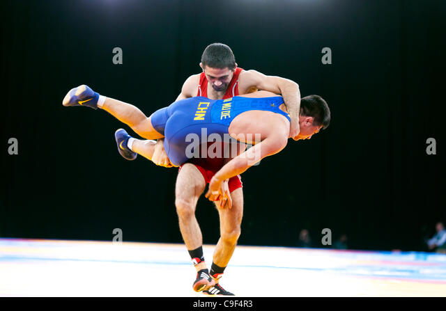 Qi MUDE  of China v Karisimir KRASTANOV of Great Britain winning Bronze in the Men's 55kg Freestyle Wrestling, - Stock Image