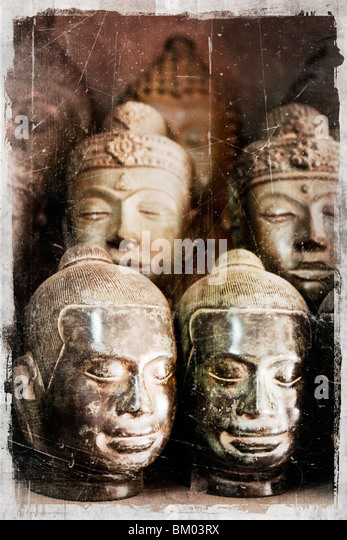 Asian sculptured heads - Stock Image