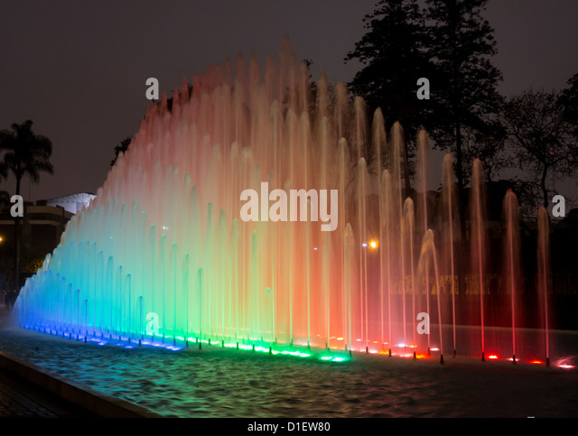 Illuminated fountains at dusk in Magic Water Tour / Circuit in Reserve Park, Lima, Peru world record for largest - Stock Image