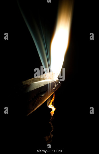 Magnesium ribbon burns. A typical high school chemistry experiment - Stock Image