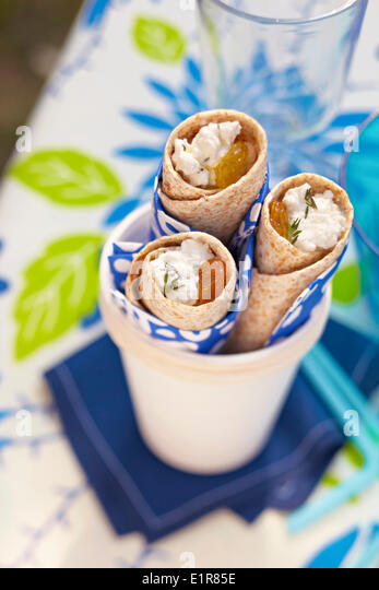 Cottage-cheese ,sultana,honey,thinly sliced peach and thyme wraps - Stock Image