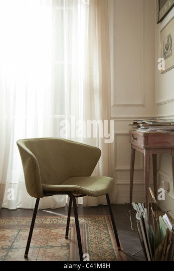 Empty chair in home - Stock Image