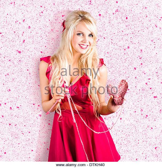 Cute woman with heart shape wool. Knitting love - Stock Image
