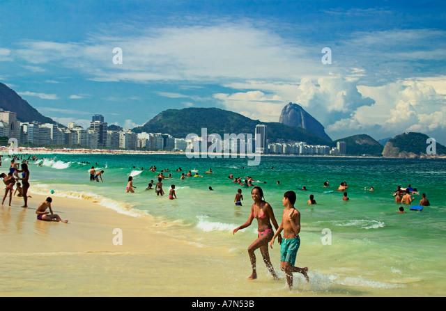 Brazil Rio de Janeiro Copacabana beach Cariocas background Poa de Acucar sugarloaf  - Stock Image