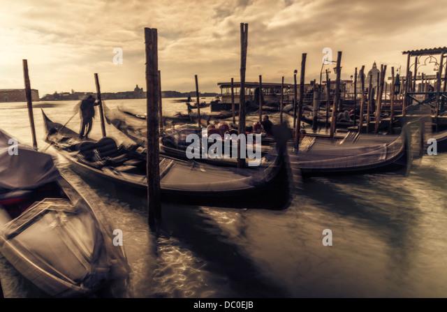venice, gondolas, sunset, sepia, waves, gondolier - Stock Image