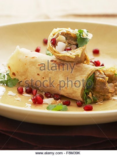 Kashmiri lamb wrapped in roti - Stock Image