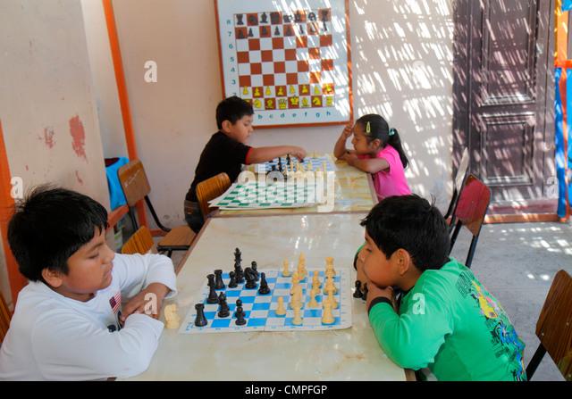 Peru Tacna Avenida Modesto Basadre chess camp board game strategy checkered gameboard white black pieces Hispanic - Stock Image