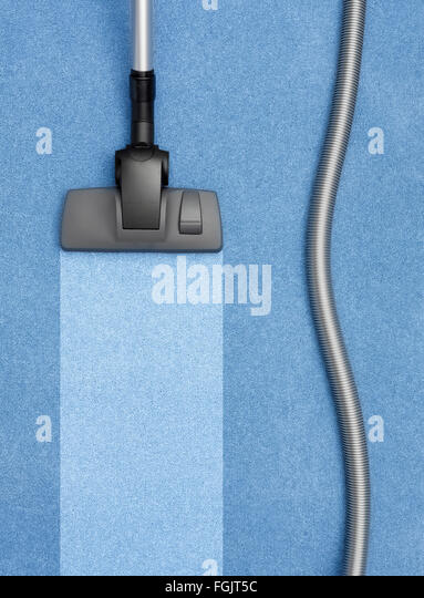 Vacuum Cleaner cleaning the carpet - Stock-Bilder