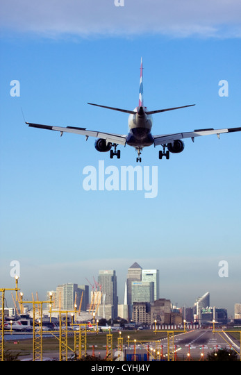 British Airways airliner landing at London City Airport, England, UK - Stock Image