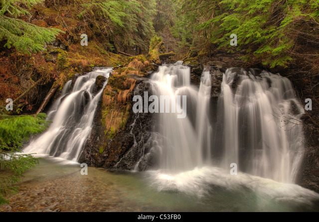 Blurred motion of Salmon Creek Falls near Juneau, Southeast Alaska, Summer. HDR - Stock Image