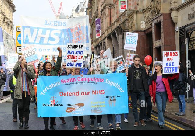 Leeds, UK. 1st April, 2017. Defend our NHS campaigners march through Leeds, 1st April, 2017 (C)Barbara Cook/Alamy - Stock Image