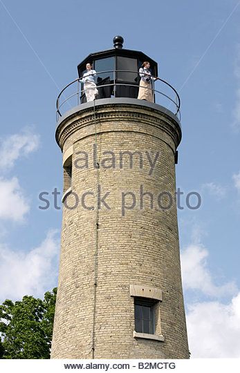 Wisconsin Kenosha Simmons Island Southport Light Station historic lighthouse built 1866 exterior woman women mother - Stock Image