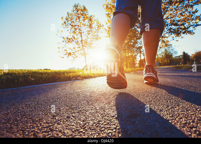 fitness background, close up of runner feet on the road - Stock Image