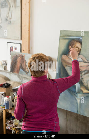Woman painting, Bavaria, Germany - Stock-Bilder