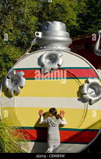 Fivels Playland kids playground with girl standing beside huge water canteen at Universal Studios Orlando Florida - Stock Image