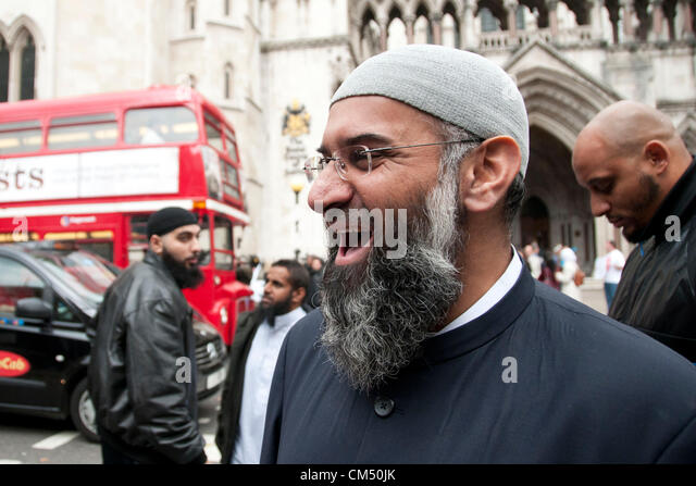 London, UK. 05/10/70. Anjem Choudary laughs as his Islamist supporters protest against the Extradition of Abu Hamza - Stock Image