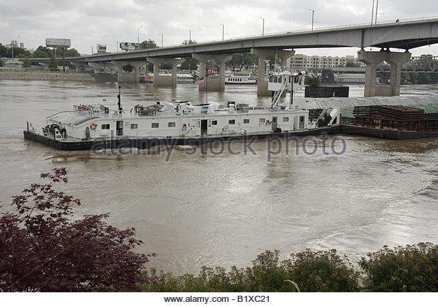 Arkansas Little Rock Arkansas River barge transport towboat bridge navigation - Stock Image