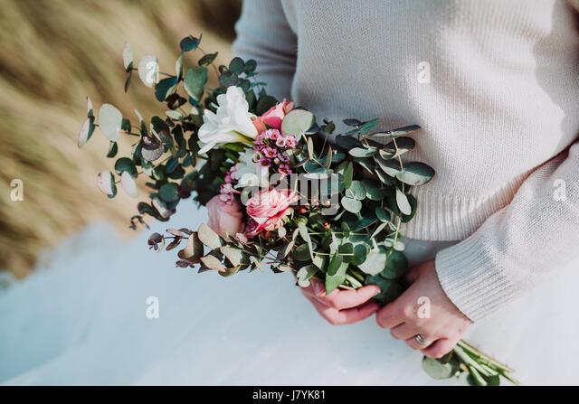 Bride holding beautiful wedding bouquet - Stock Image
